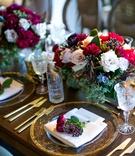 Dark wood tables no linens low flower arrangements centerpieces flowers on top of menu gold charger