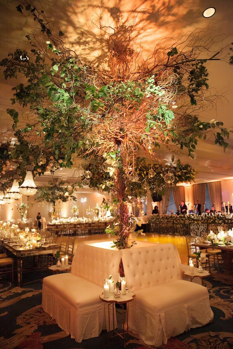 Tall tree flower arrangement behind lounge furniture rentals