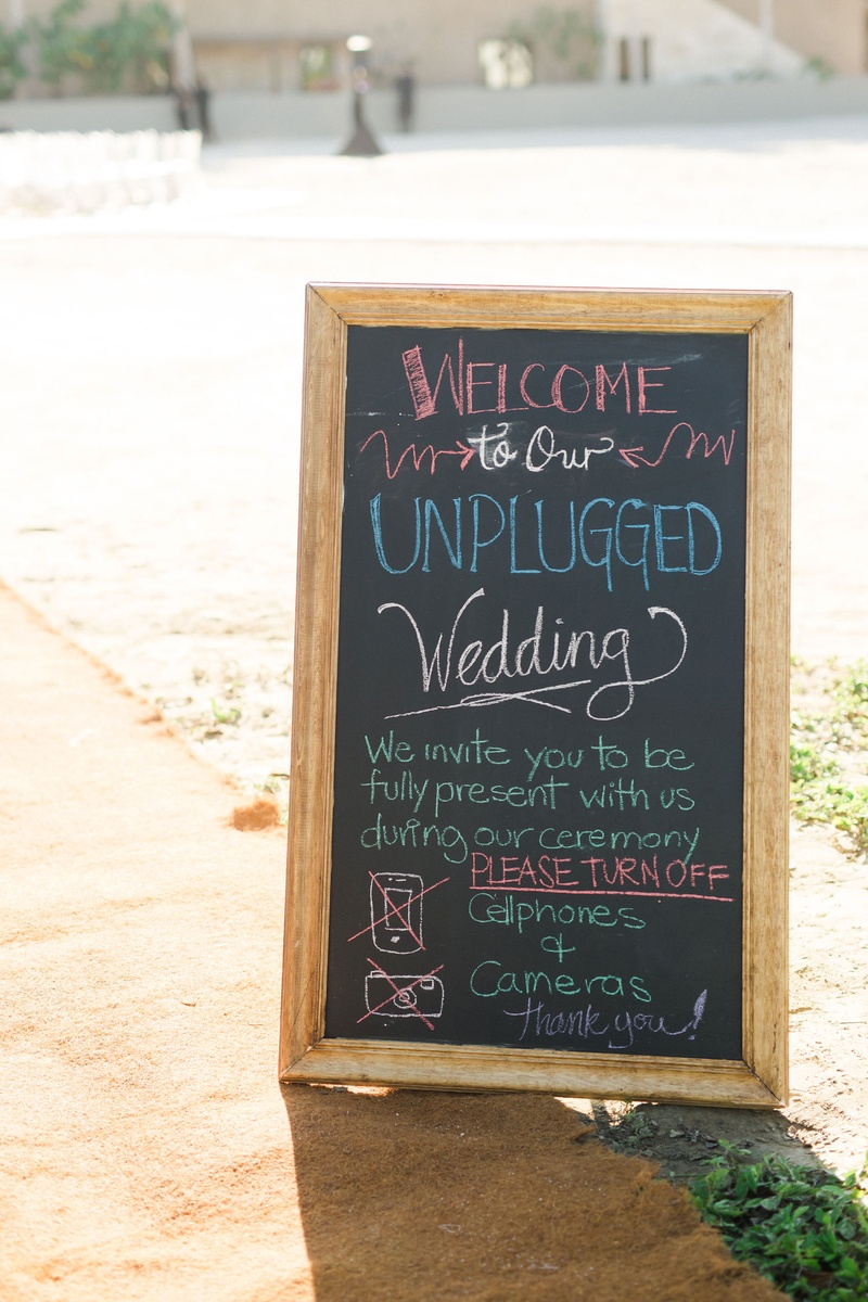 wedding ceremony with chalkboard colorful chalk unplugged wedding no cell phones or cameras