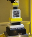 Black, yellow, and silver wedding cake with ostrich feathers