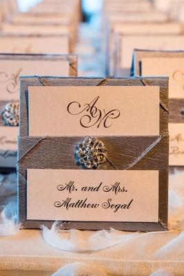 Grey silver wedding reception escort card with jewel detail