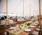 tented reception, long table with green table runner light pink candles wedding