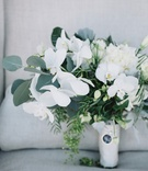 bouquet with orchids, eucalyptus, ferns, charm with loved one