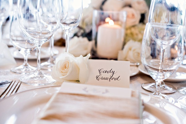 Wedding guest cindy crawford white rose candle glassware napkin simple place setting