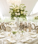 striped linen square tablescape tall centerpiece wedding reception tented white rustic chic floral