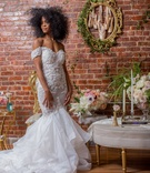 bride in pantora bridal off-the-shoulder mermaid dress, black bridal model with natural hair