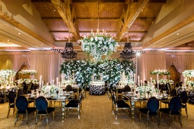 george springer astros wedding ballroom black gold chairs flower wall and flower chandelier