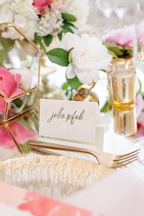 wedding reception place card gold calligraphy and flatware terrarium pink peony flower