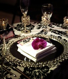 Crystal chargers and damask tablecloth