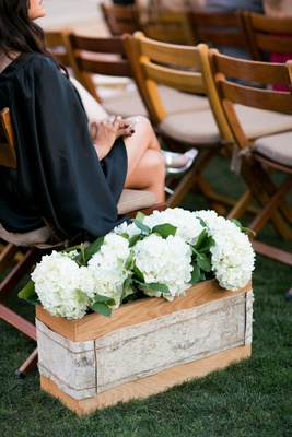 Birch bark wrapped around wood box and white hydrangea