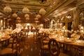 wedding reception the mar-a-lago club opulent luxury ballroom chandelier serpentine table oval back