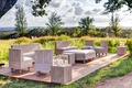 Outdoor wedding lounge area with furniture composed of wooden slats