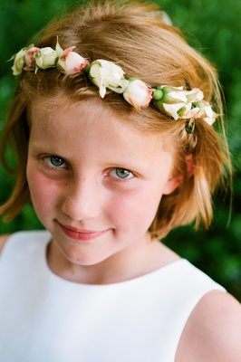 Flower girl with red hair wearing pink and white flower crown