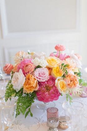 wedding reception centerpiece pink peony yellow rose orange garden rose ranunculus greenery