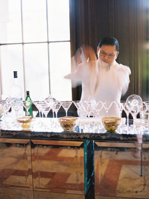 Wedding reception cocktail hour his libation station martini bar bartender martini glasses
