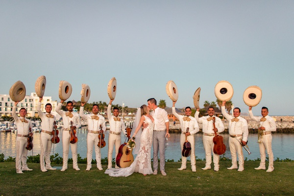 mariachi band at destination wedding in cabo san lucas with bride and groom
