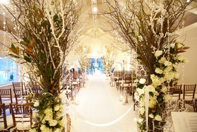 White runner lined with branches and crystals