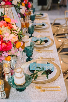 white linen gold blue plates wedding reception pink orange flowers blue goblets