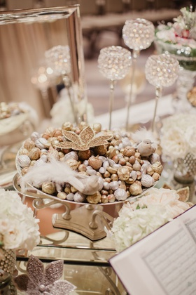 Wedding ceremony persian wedding sofreh table at ceremony candies and candles on table traditional