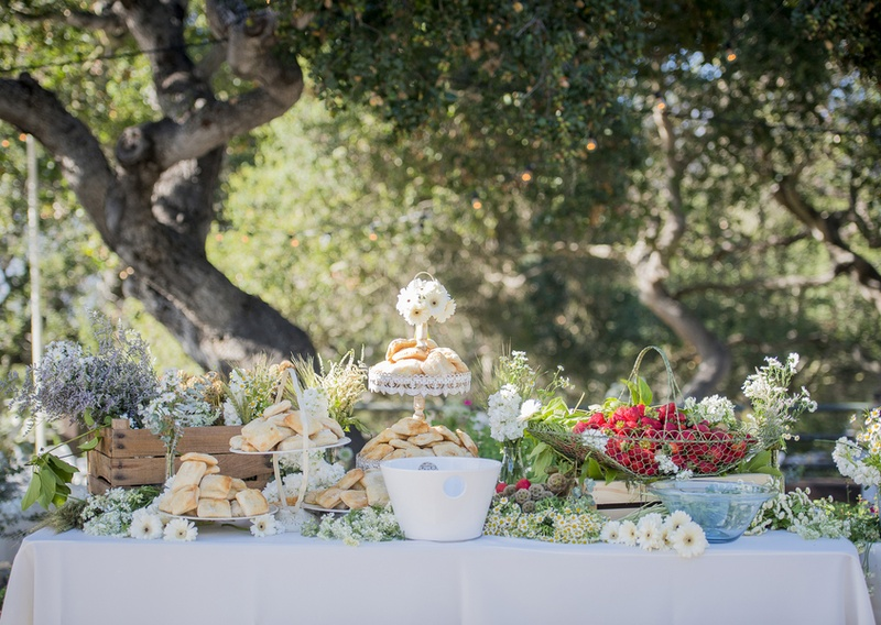 strawberry shortcake pastry station decorated with white wildflowers baskets fresh food