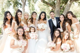 bride in nicole spose with bridesmaids in christina wu, bridesman, and flower girl