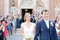 Bride in a lace Watters dress with cap sleeves dances exits ceremony with groom in royal blue suit