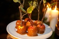Mini candy apples with sticks and leaves
