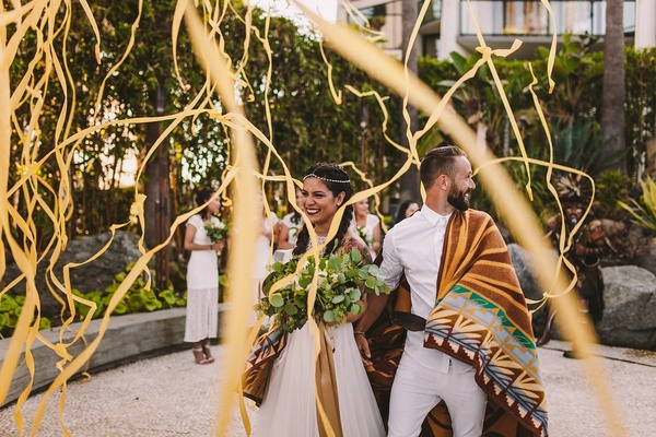 native american latina bride in bhldn, chumash ceremony blanket, streamers for recessional