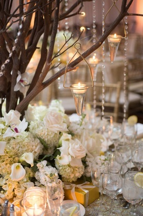 Cone shape tea light holders hanging from tree centerpiece
