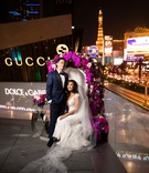 bride in cristiano lucci wedding dress, bride and groom on throne las vegas strip