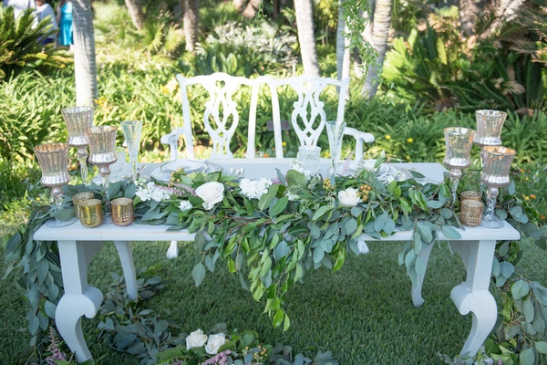 Vintage sweetheart table and chairs, mercury glass candleholders, greenery, white roses in reception