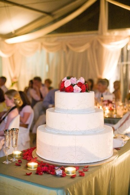 Three layer wedding cake with roses on top