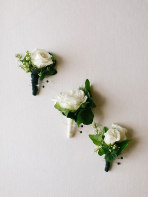 wedding flowers white rose boutonniere with greenery black white ribbon