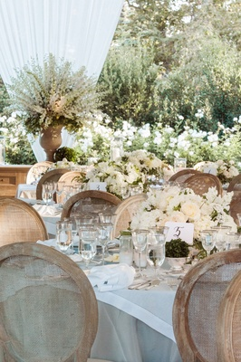 White and taupe table linens with white wedding centerpiece