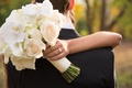 Bride's bouquet of whiter flowers wrapped in fabric