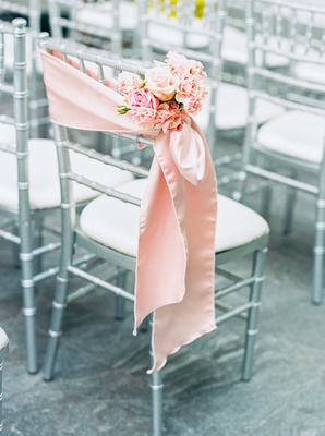 silver gray ceremony chair pink silk stain fabric small cluster of pink and white flowers