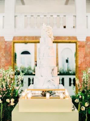 mariana paola vicente and kike hernandez wedding cake marble design white sugar flowers ballroom