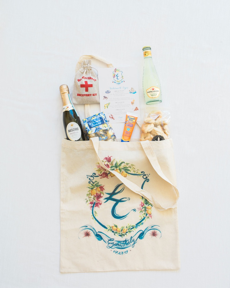 wedding welcome tote bag with painted monogram, favors and emergency kit