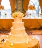 wedding reception decor four layer wedding cake sugar flower decorations ribbon base hydrangea