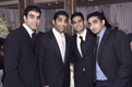 Indian American groomsmen in suits