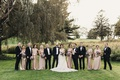 bridal party portrait outdoors, groomsmen in black tuxes, bridesmaids in rose gold dresses