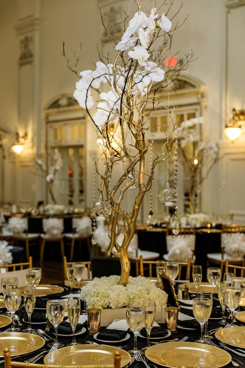 Reception décor photos gold manzanita branches with