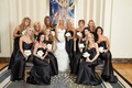 bride in rivini, bridesmaids in Alvina Valenta black strapless floor length bridesmaid dresses