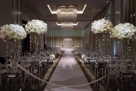 chicago ballroom ceremony venue chandeliers white flowers orchids roses hydrangea round back chairs