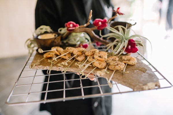 Shrimp on toothpicks with dipping sauce at wedding