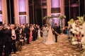 bride in elan, mother of the bride in Manish Malhotra, bride walks down aisle with parents