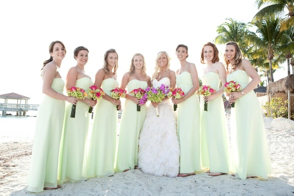 Bridesmaids in long dresses and flip flops with bride