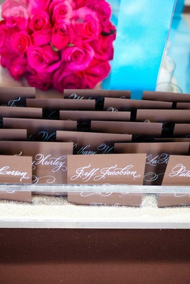 Seating cards with calligraphy on chocolate stationery