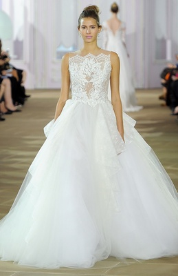 Sleeveless tulle ball gown with illusion bodice and back, lace appliqués and cascading tulle skirt a