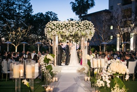 wedding ceremony after sunset jewish tradition birch branch candles white flowers greenery